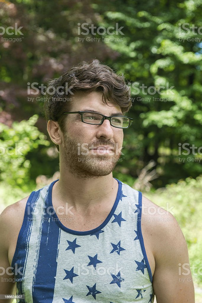 All American Man Standing In Front of Trees royalty-free stock photo