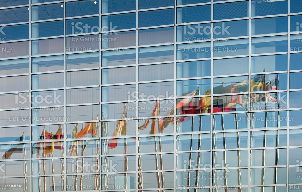All European Union member countries flags reflected in facade stock photo