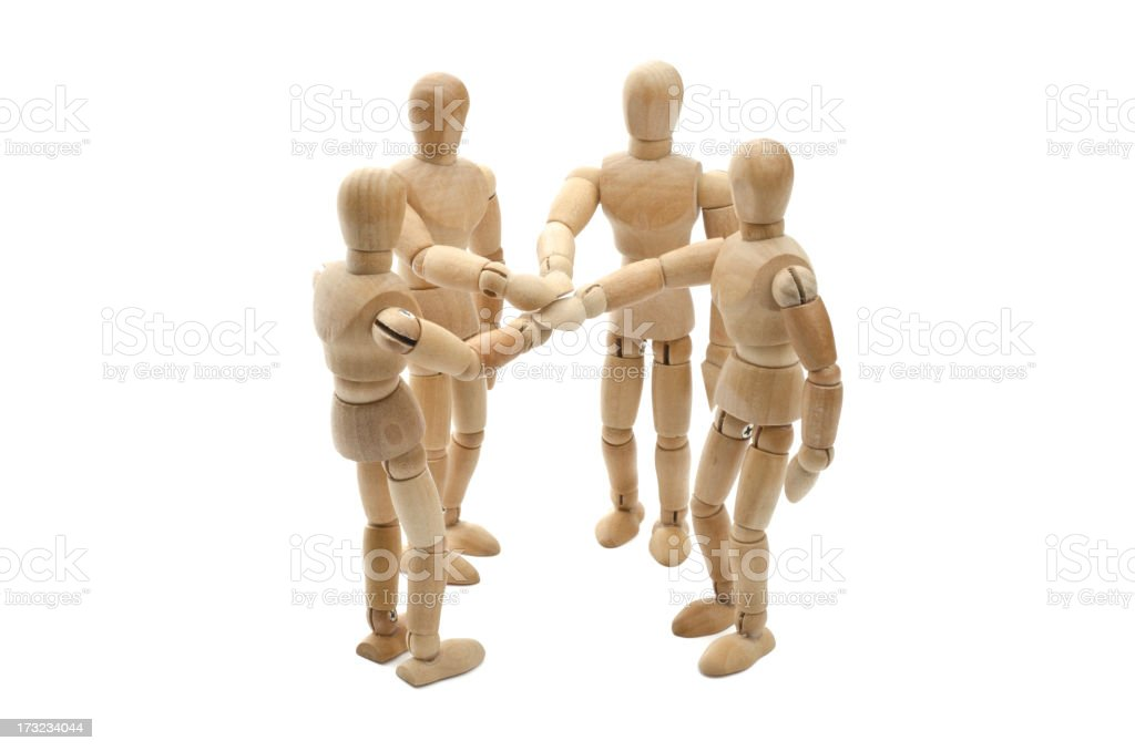 all for one - Wooden mannequin putting hands together stock photo