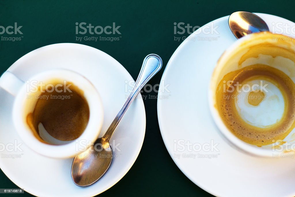 All Gone: Two Empty White Coffee Cups on White Saucers stock photo
