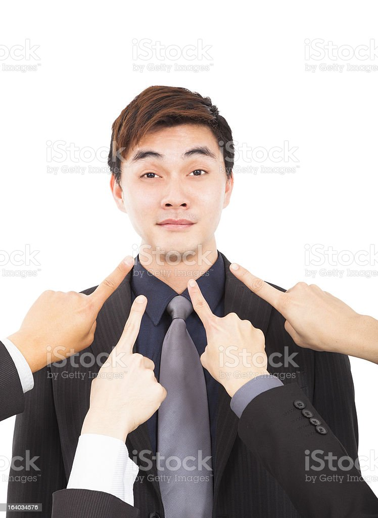 all hands pointing towards businessman royalty-free stock photo