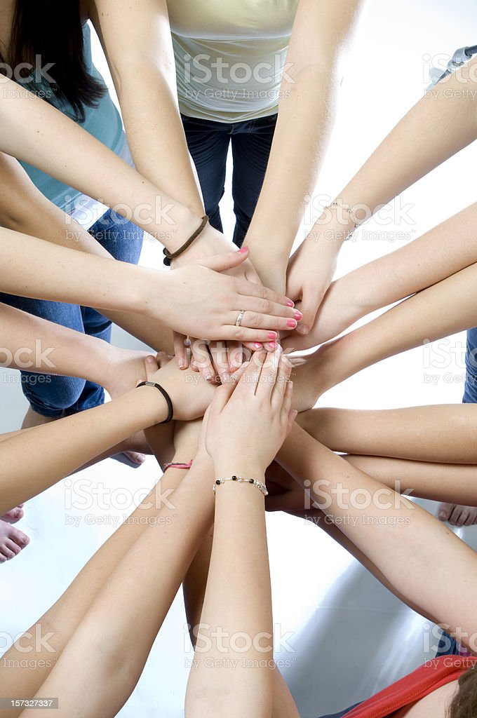 all hands together royalty-free stock photo