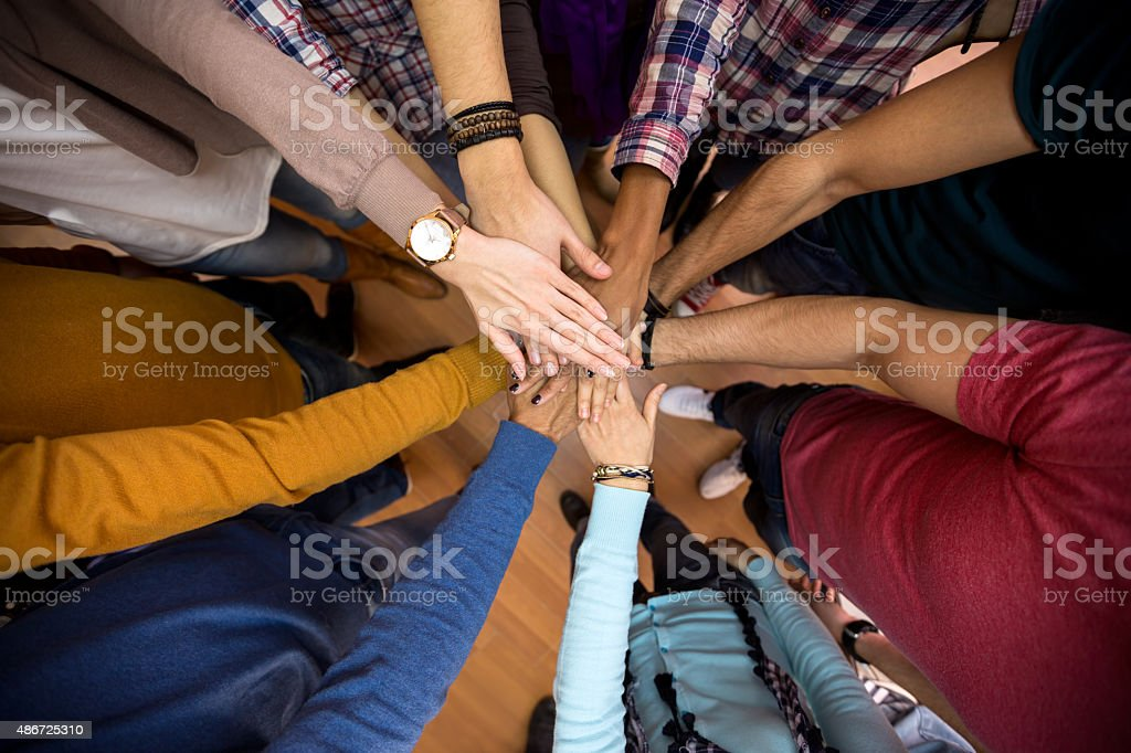 All hands together, racial equality in team stock photo