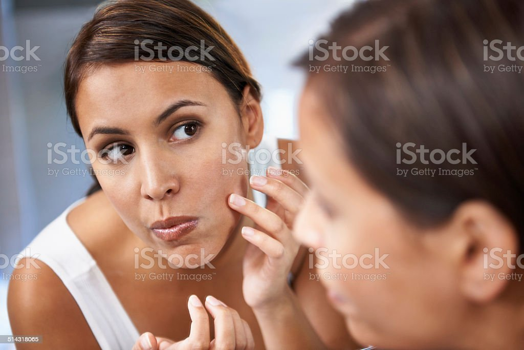 All her blemishes have disappeared stock photo