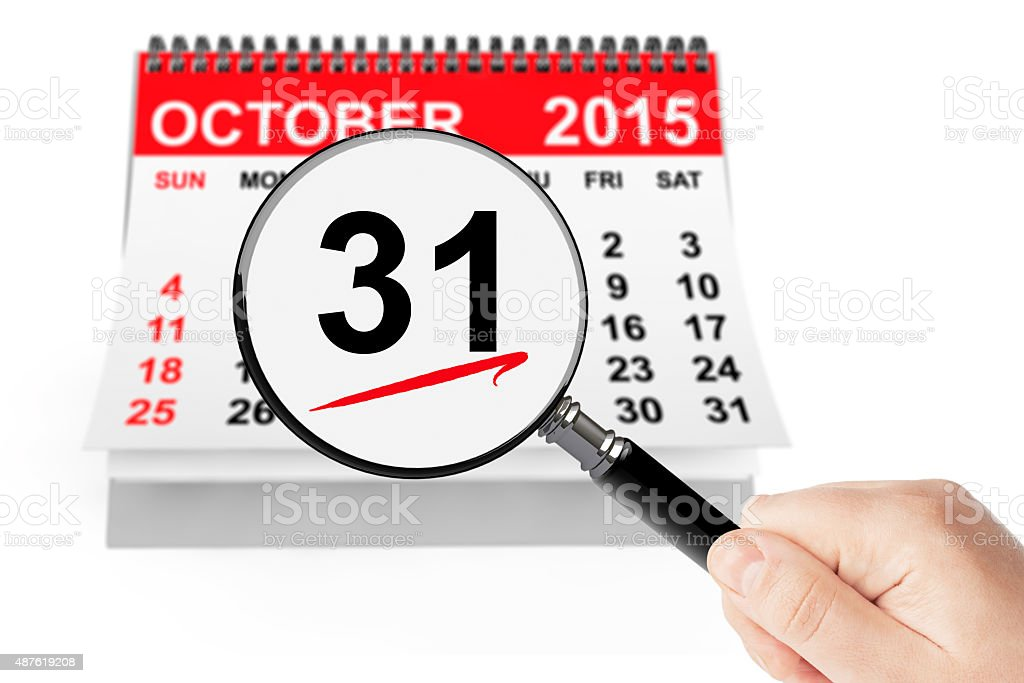 All Saints Day Concept. 31 October 2015 calendar with magnifier stock photo