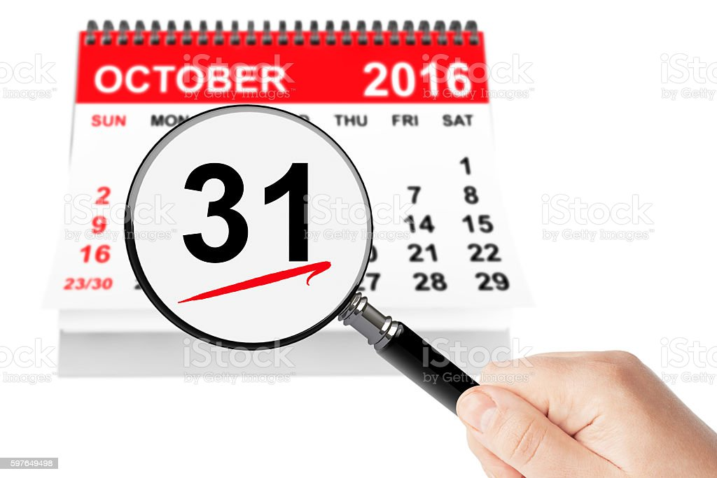 All Saints Day Concept. 31 October 2016 calendar with magnifier stock photo