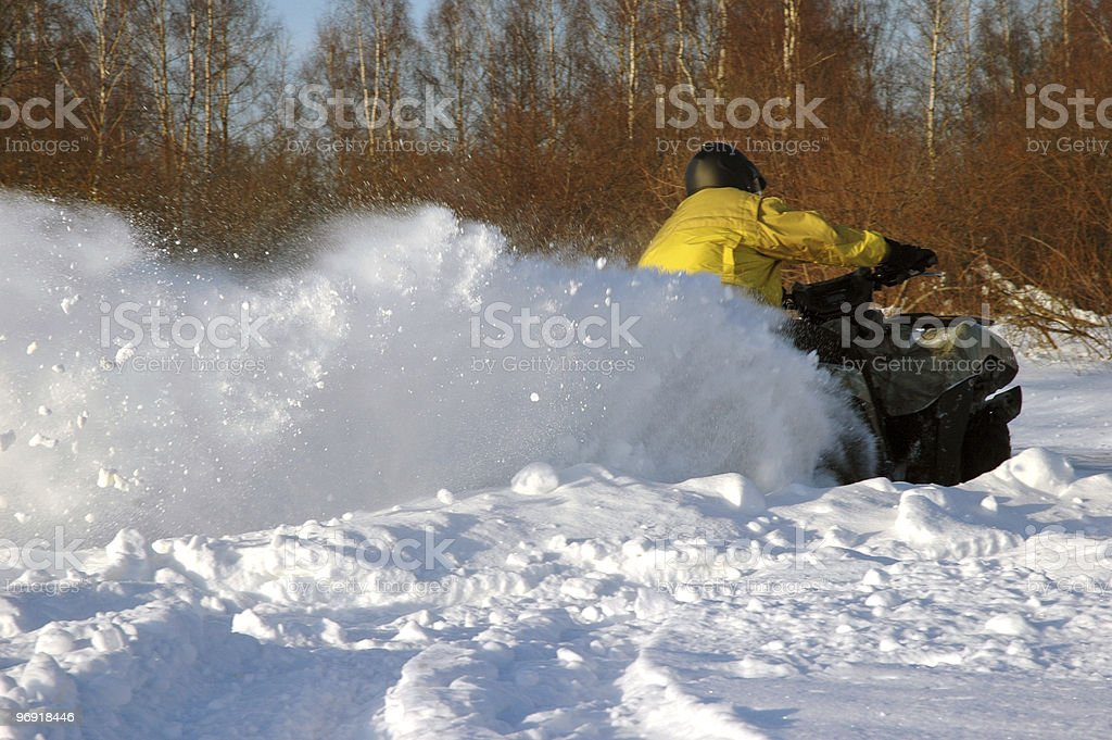 all terrain vehicle in motion at winter stock photo