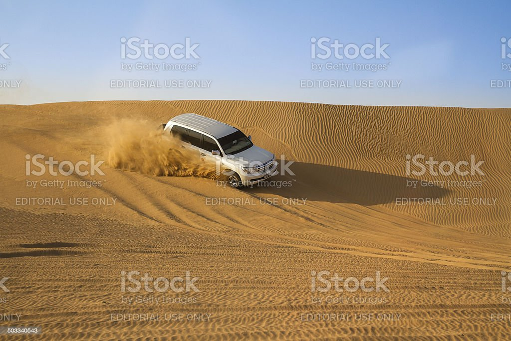 All-terrain vehicle driving through the desert, in a recreational...