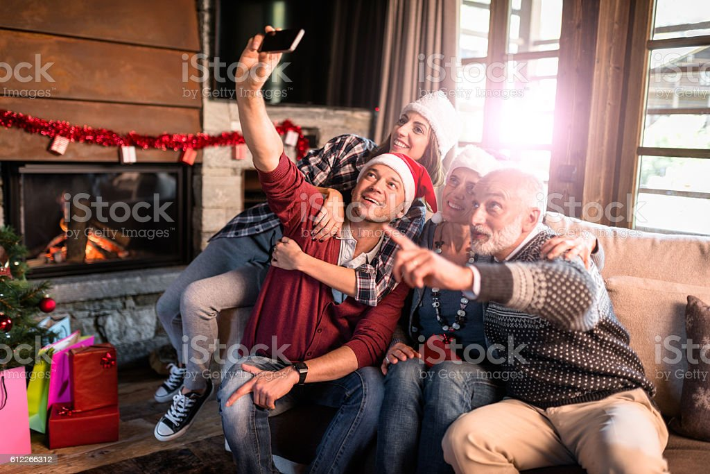 all the family taking a selfie for christmas stock photo