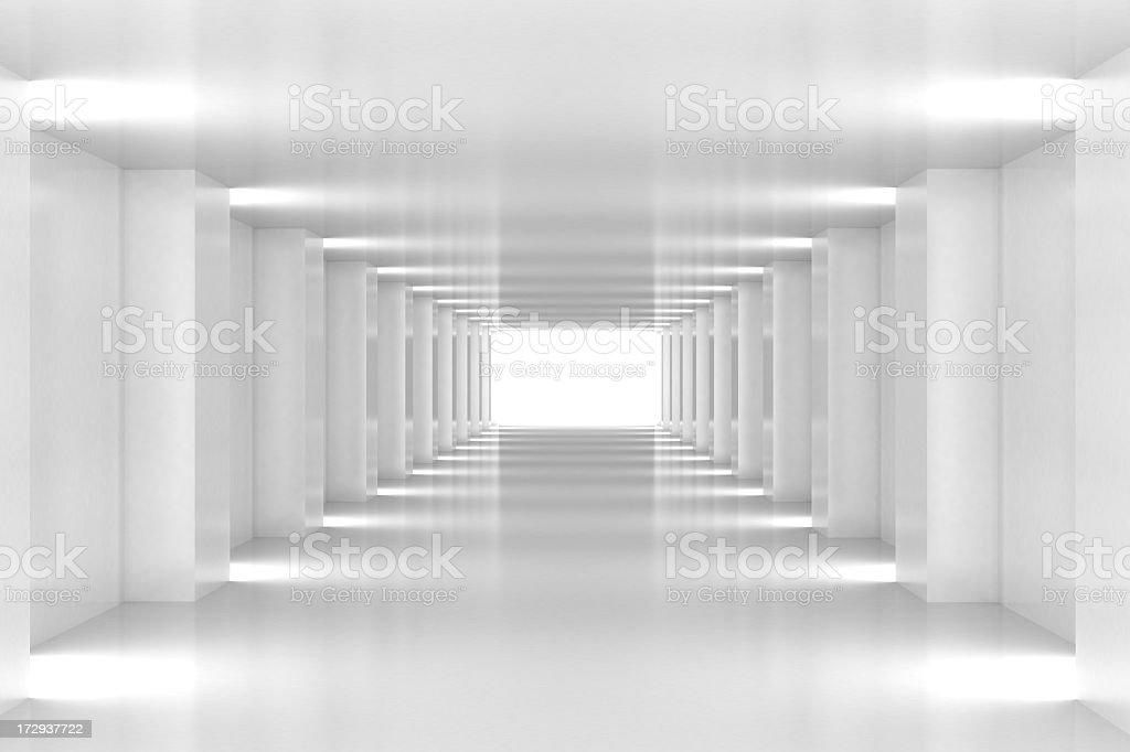 All white corridor ends in bright light stock photo