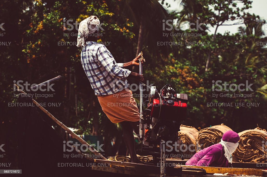 Allepey, Kerala, India March 31, 2015: Indian man transport dwell stock photo