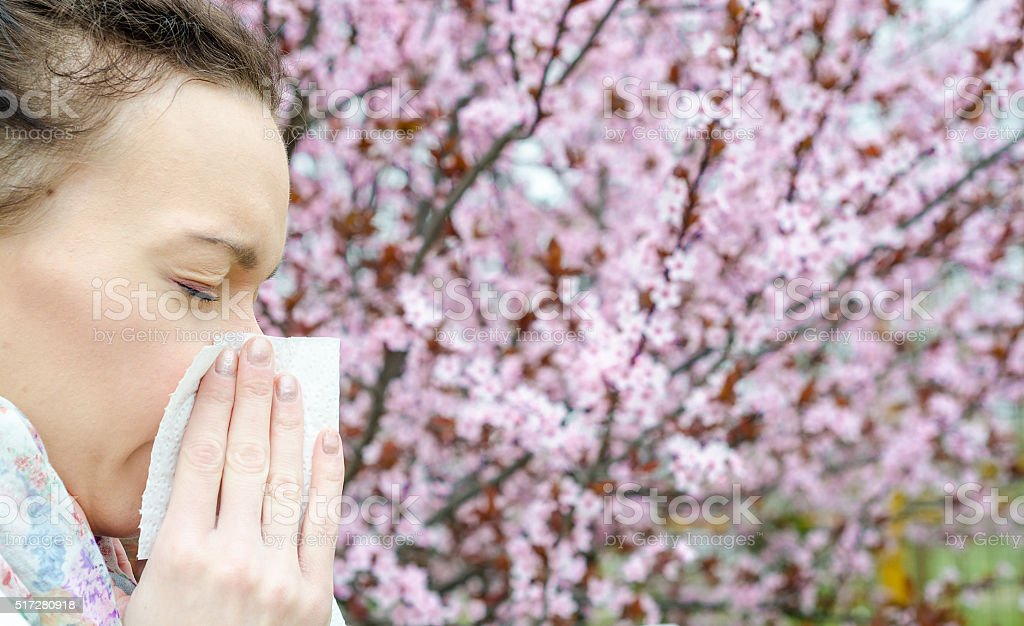 Allergic reactions to spring flowers, pollen, ragweed, stock photo