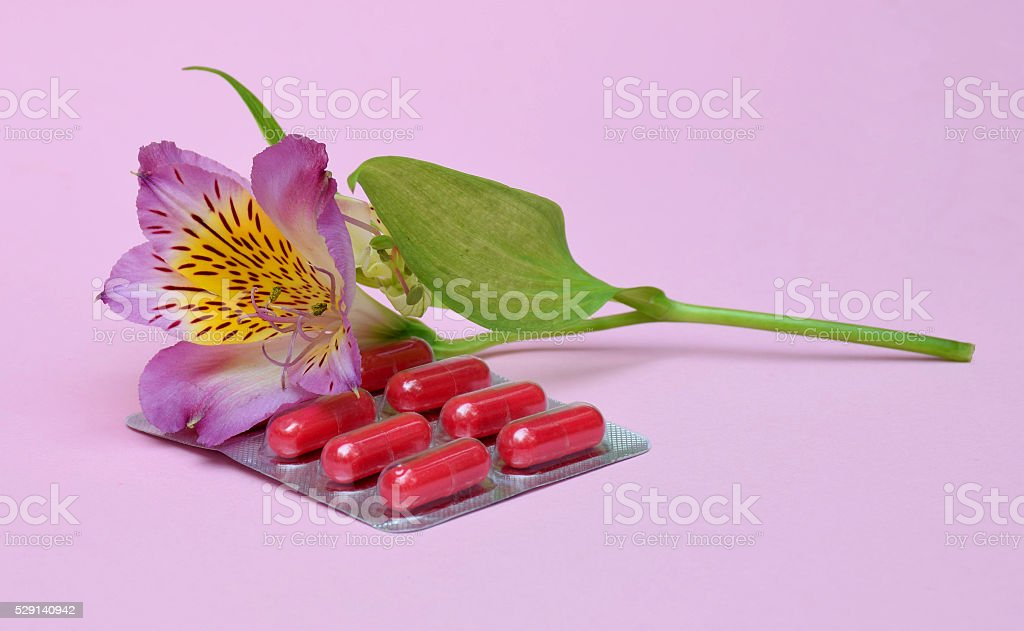 Flower astromelii and tablets from allergies. Journey. Climate...