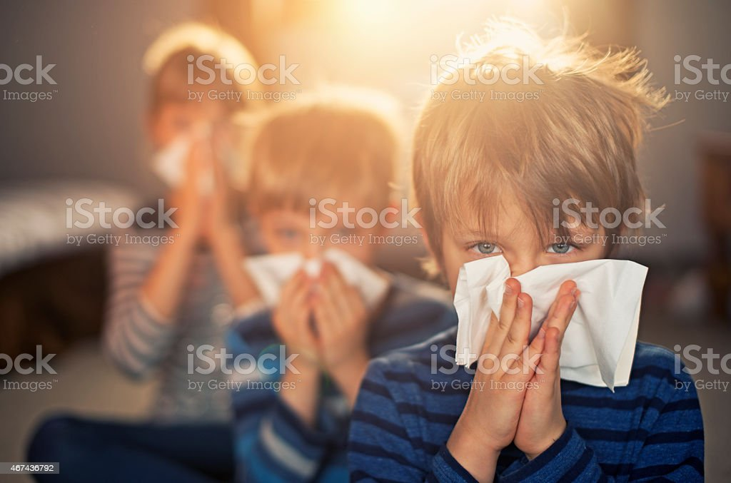 Allergy generation - kids blowing noses stock photo