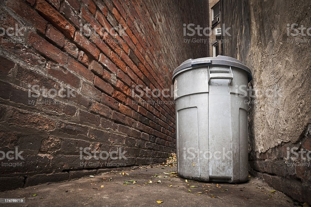 Alley garbage can stock photo
