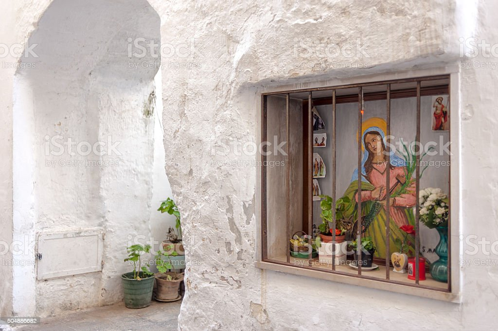 Alley in Gallipoli with altar dedicated to Our Lady stock photo