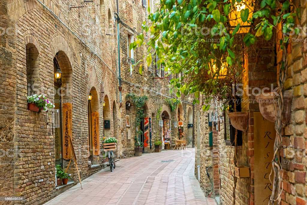 Alley in old town San Gimignano Tuscany Italy stock photo
