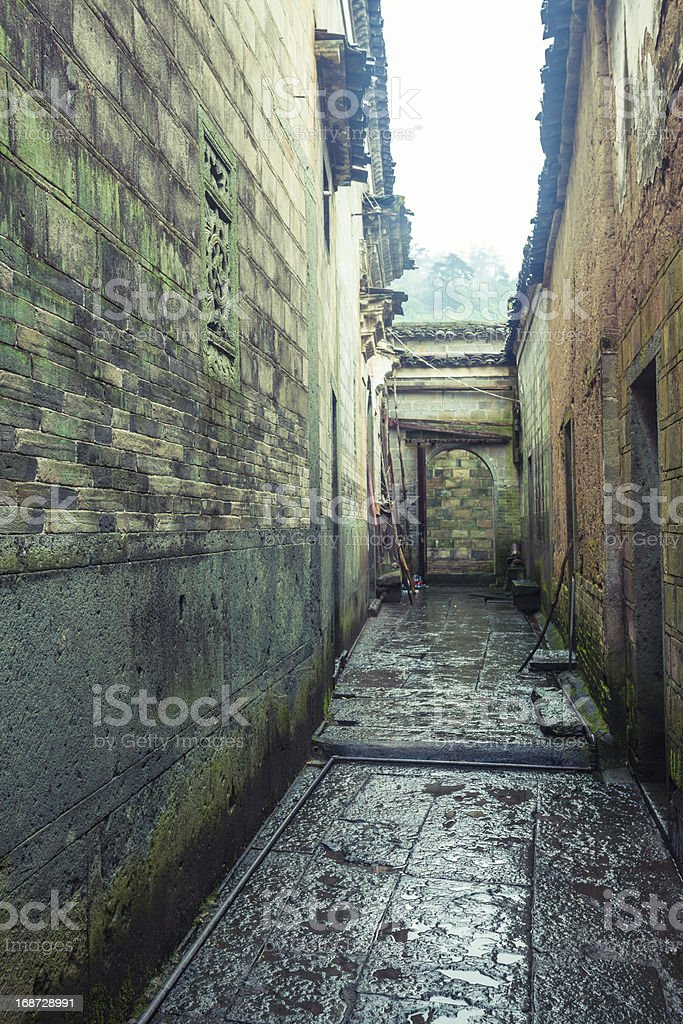alley in old village stock photo
