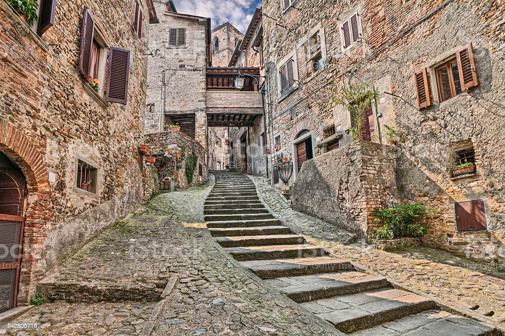 alley in the medieval village Anghiari, Arezzo, Tuscany, Italy stock photo