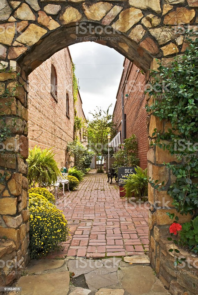 alley in Warm Springs Georgia landscaped with flowers and plants royalty-free stock photo