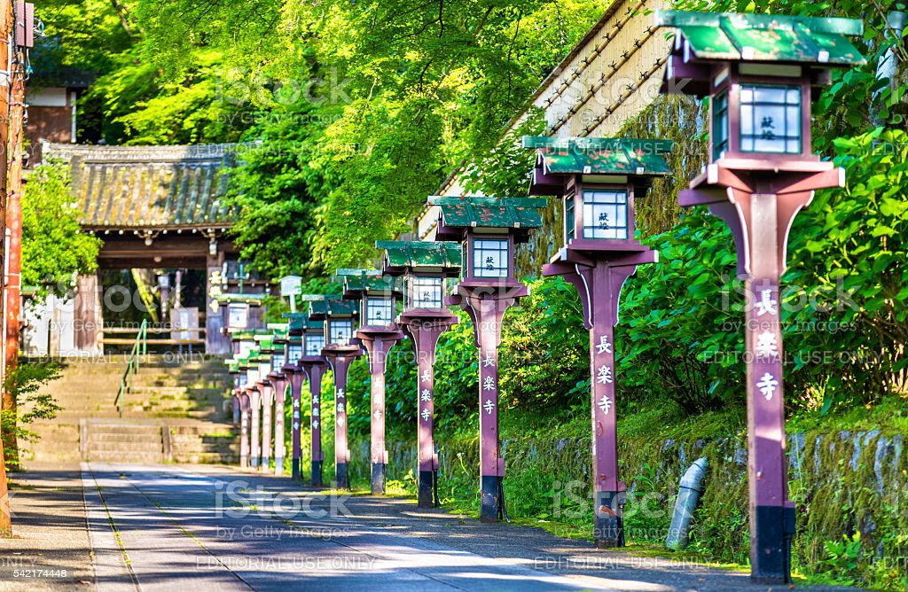 Alley of wooden lanterns at Chorakuji Temple in Kyoto stock photo