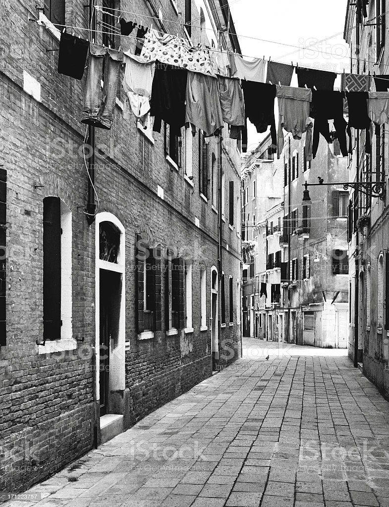 Alley with laundry. Black and White royalty-free stock photo