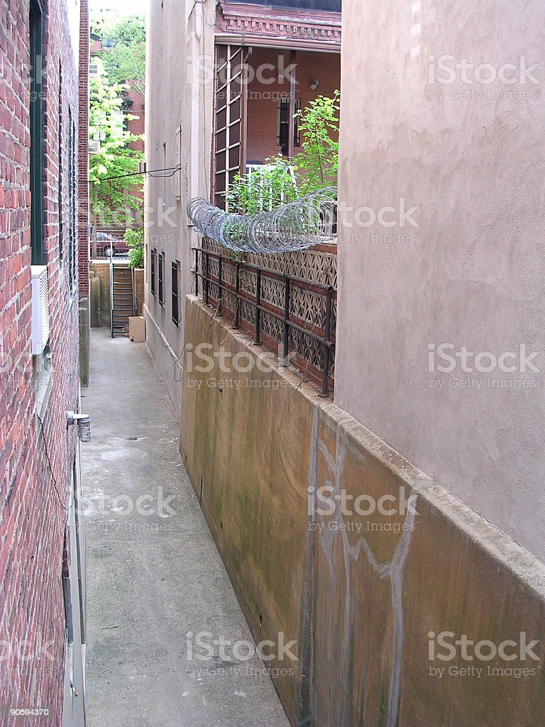 Alleyway with Barbed Wire in Brooklyn royalty-free stock photo