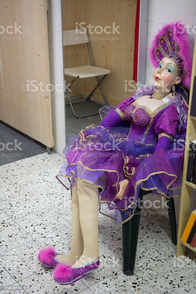 Allmost lifesize howgirl sitting in a chair stock photo
