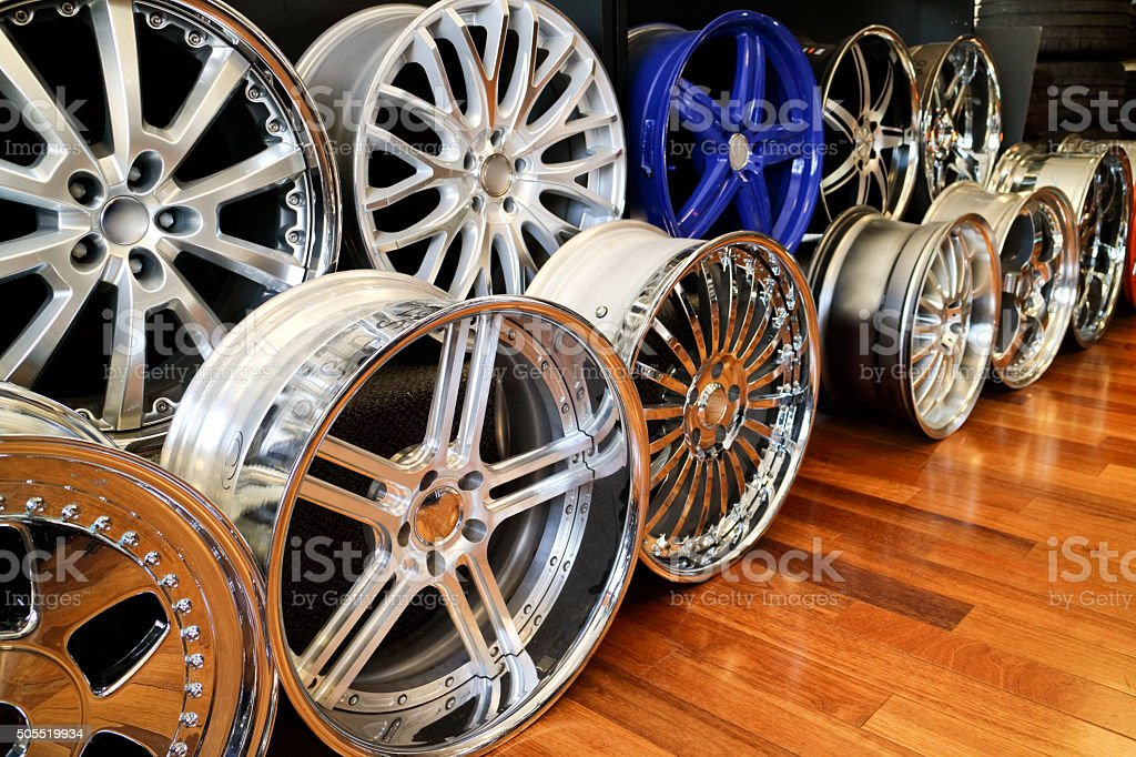 Alloy rims in a row showroom floor, chrome, aluminum Bling stock photo