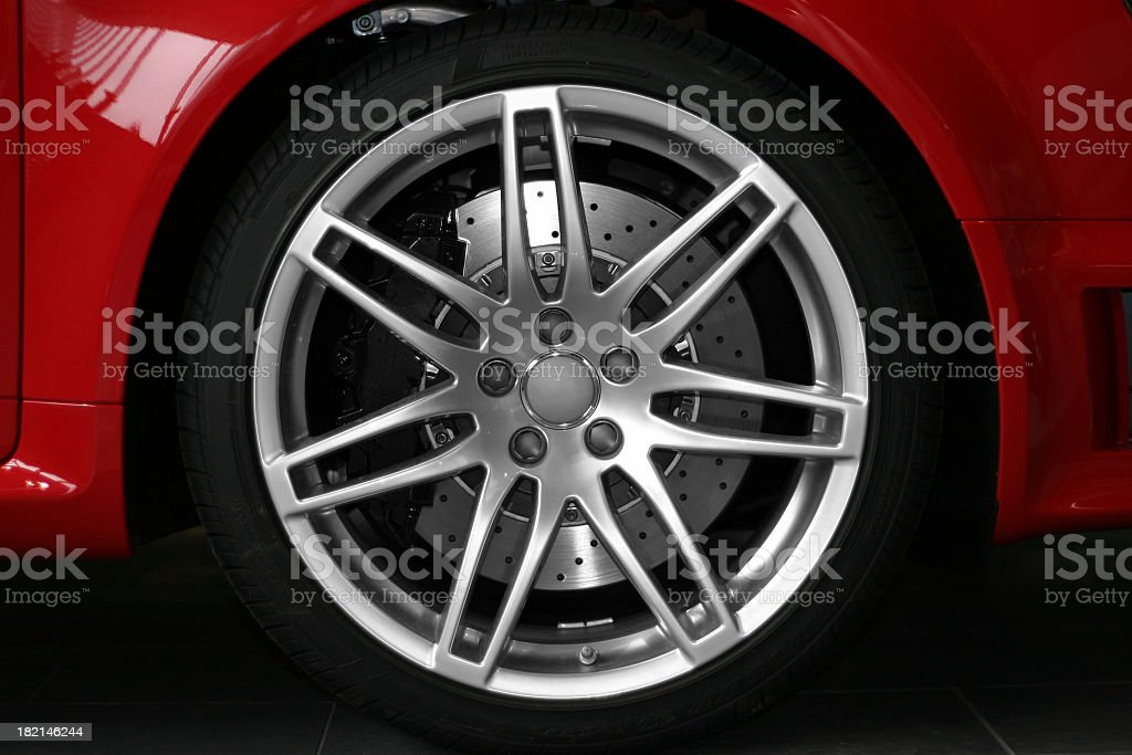 Alloy wheel close up of red sportive car royalty-free stock photo