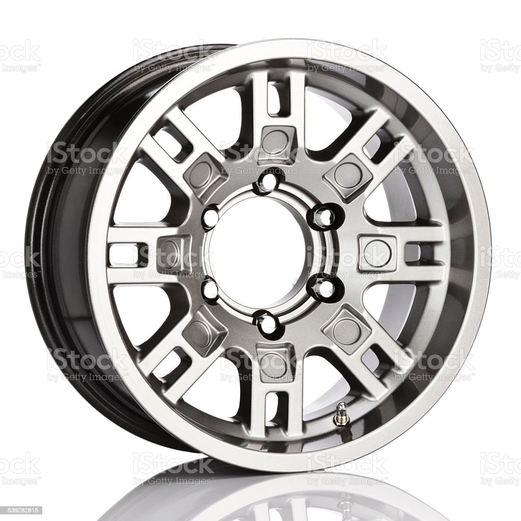 Alloy wheel isolated on reflective white backdrop. Side view stock photo