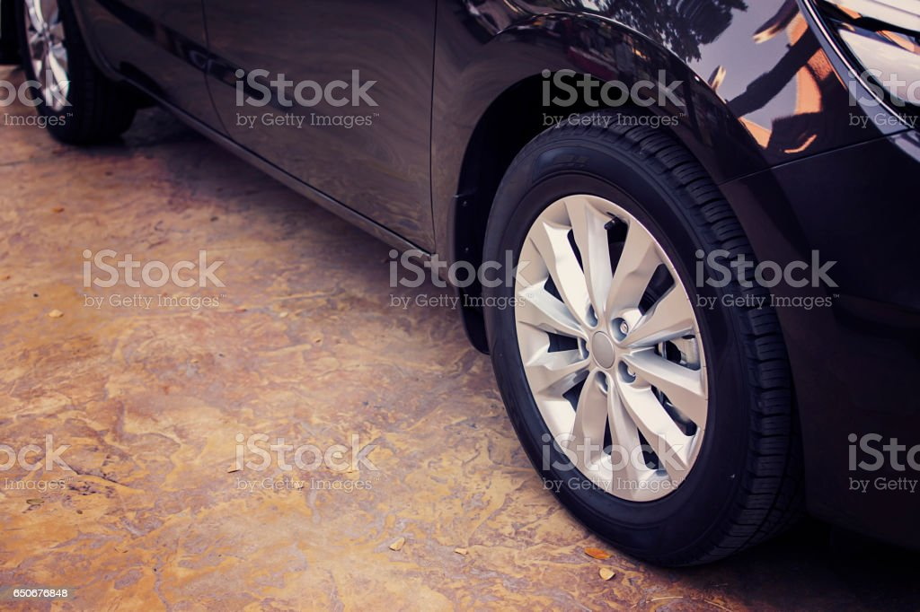 Alloy wheel of luxury car in view side. stock photo
