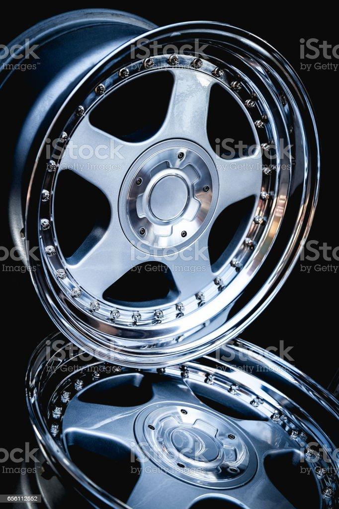 Alloy wheel rims on black stock photo