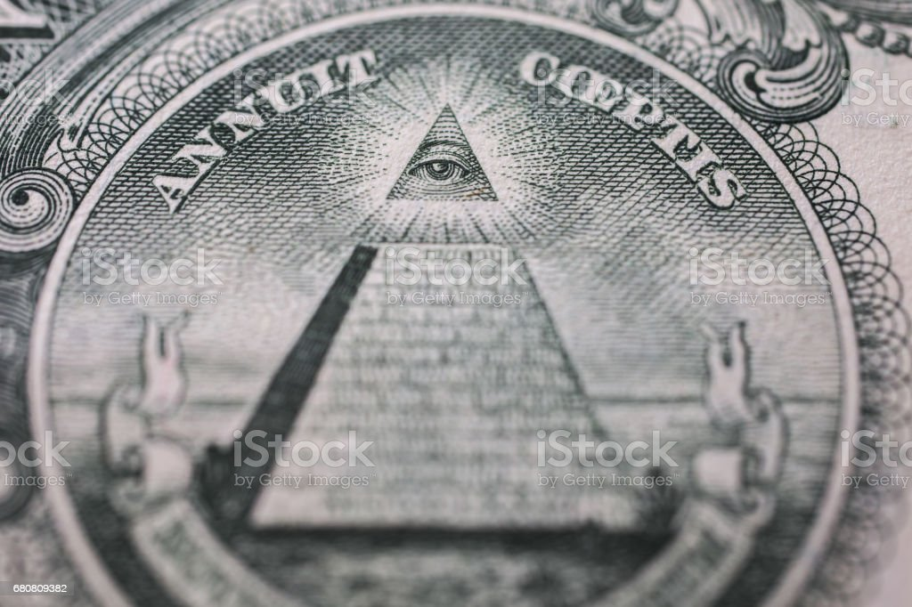 all-seeing eye, truncated pyramid closeup, money background ,one dollar bill down back reverse side, background of dollars, close up, America stock photo