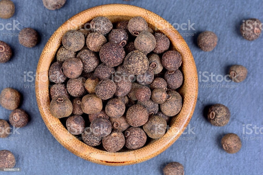 Allspice in a bamboo bowl stock photo