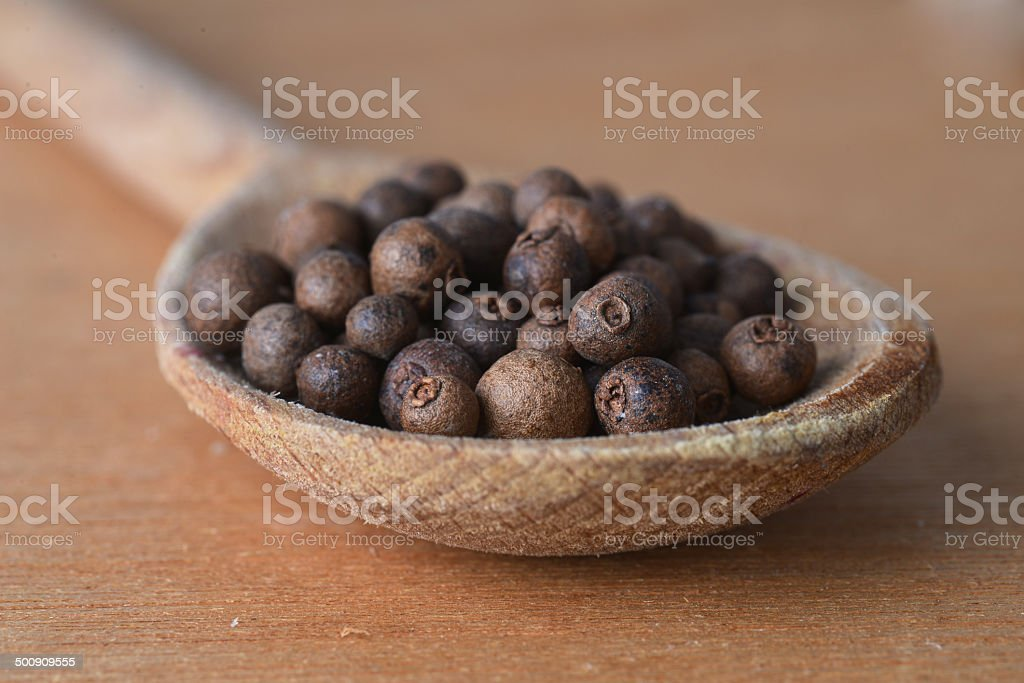 allspice  in  spoon stock photo