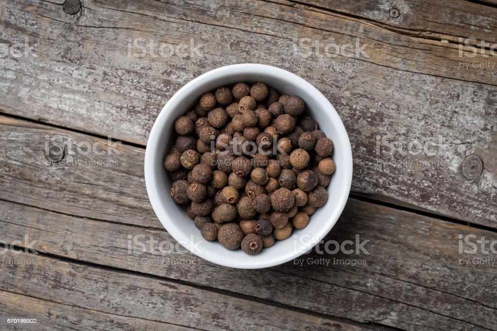 Allspice in white bowl stock photo