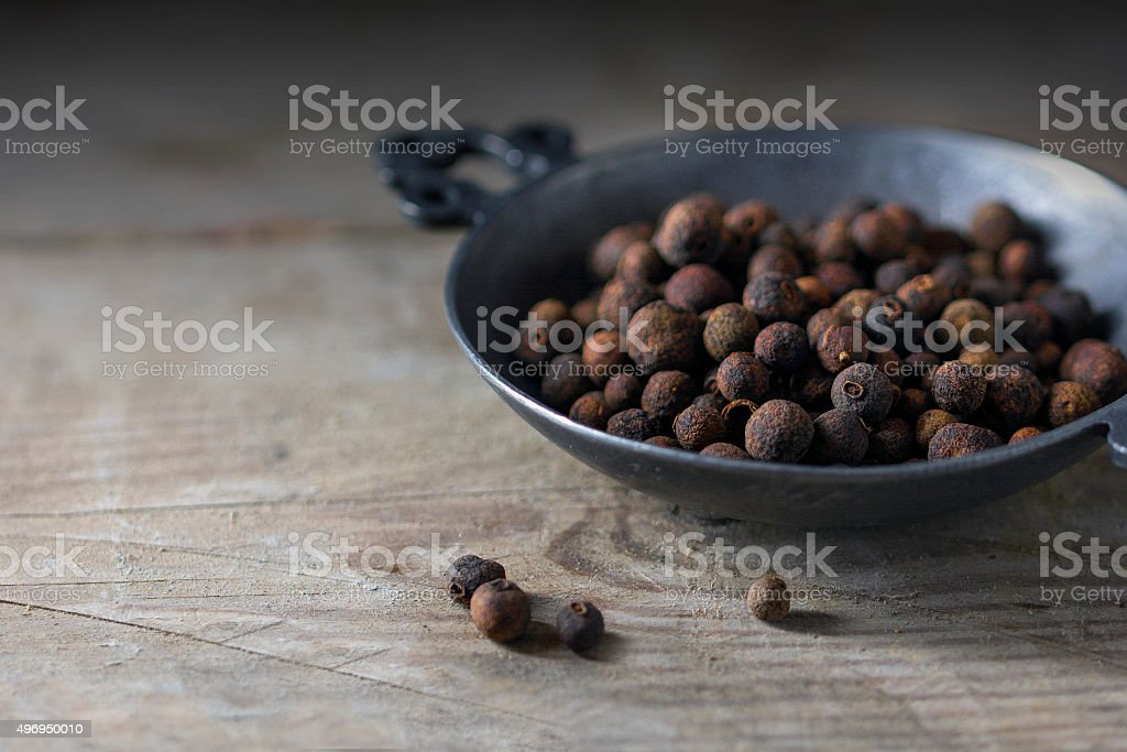 Allspice or english pepper in a  metal bowl stock photo