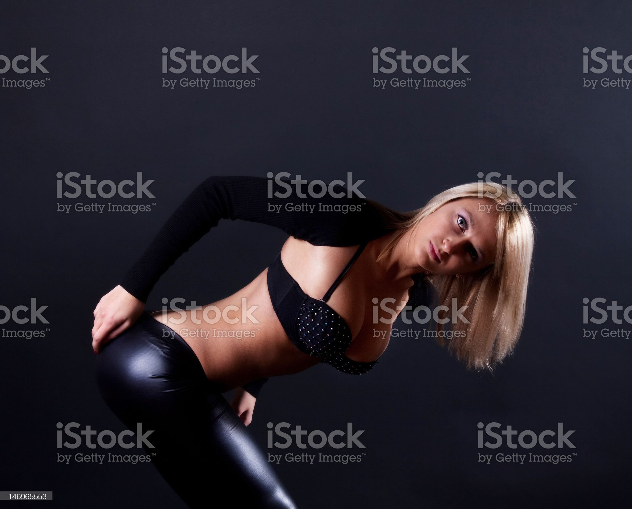 alluring and fashion dancer posing against dark background royalty-free stock photo