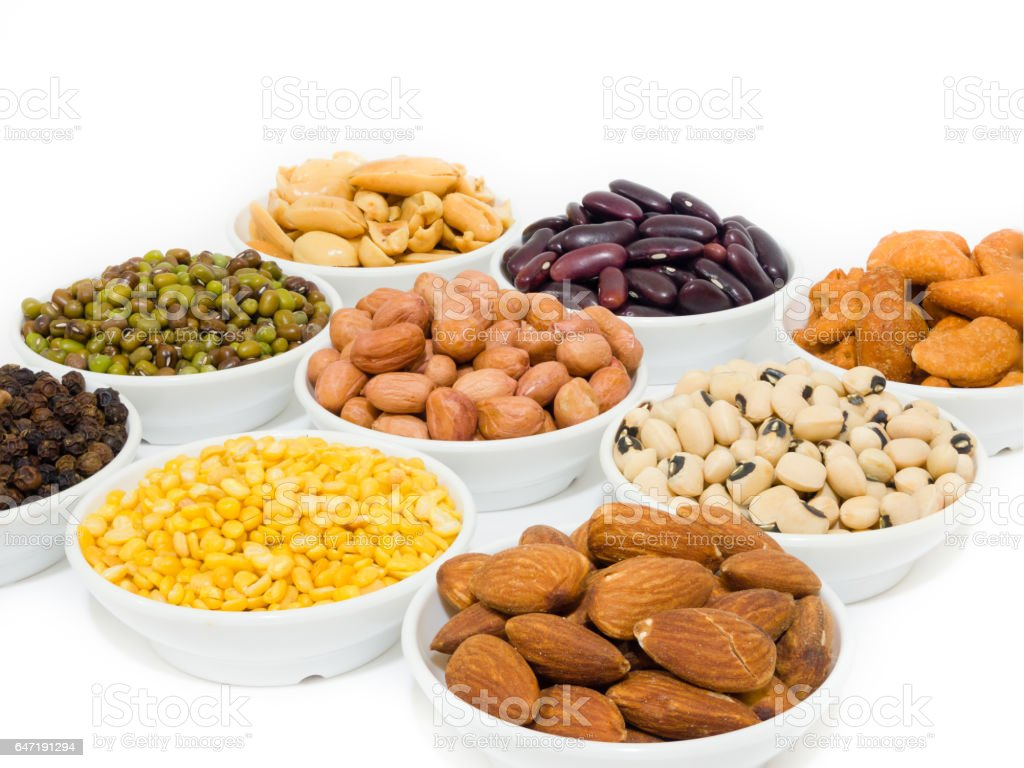 Almond, Cashew nuts, yellow bean, green bean, rice, fettucine, all put on small white cup and on white background stock photo