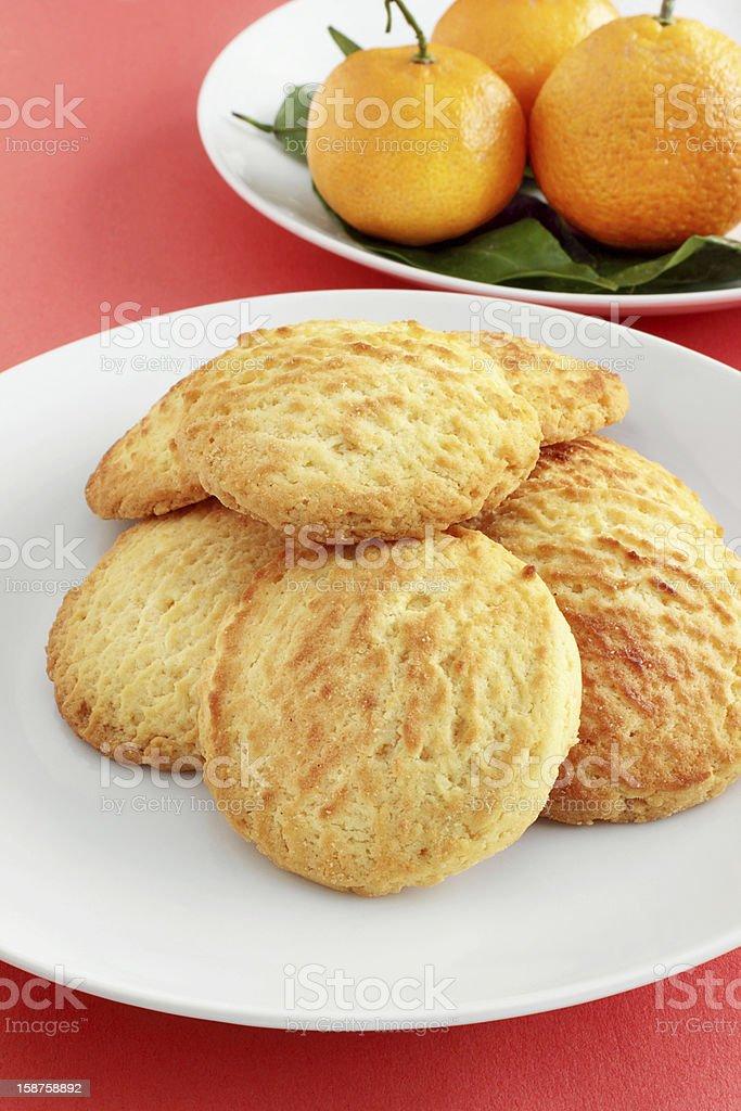 Almond cookies with mandarin oranges stock photo