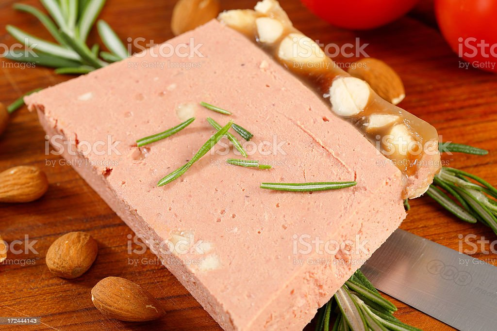 Almond liver pate on a round cutting board stock photo