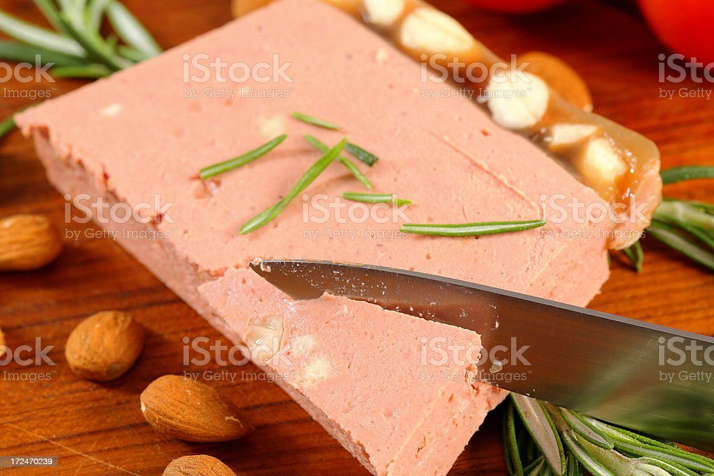 Almond liver pate on a round cutting board royalty-free stock photo