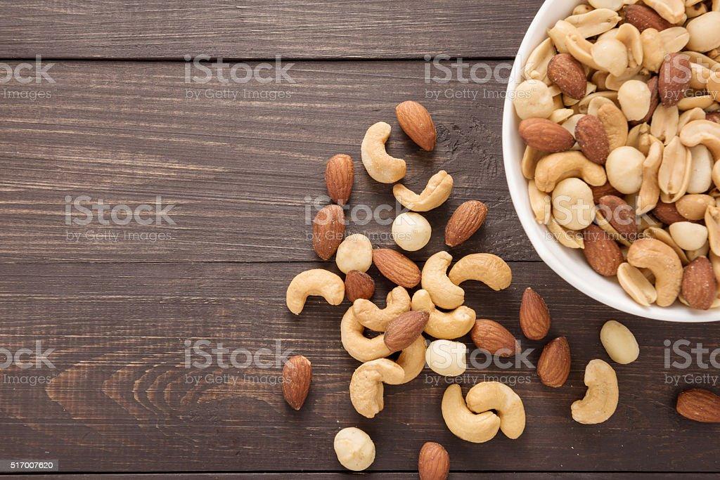 Almond, macadamia, peanut, cashew are in a blow. stock photo