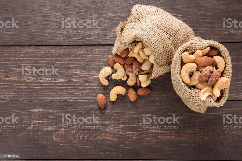Almond, macadamia, peanut, cashew are in suck bags stock photo