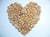 Almond nuts arranged in heart shape