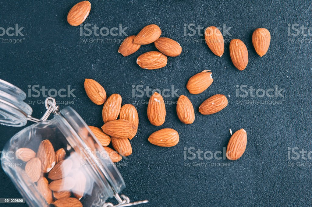 Almond nuts on a dark background stock photo