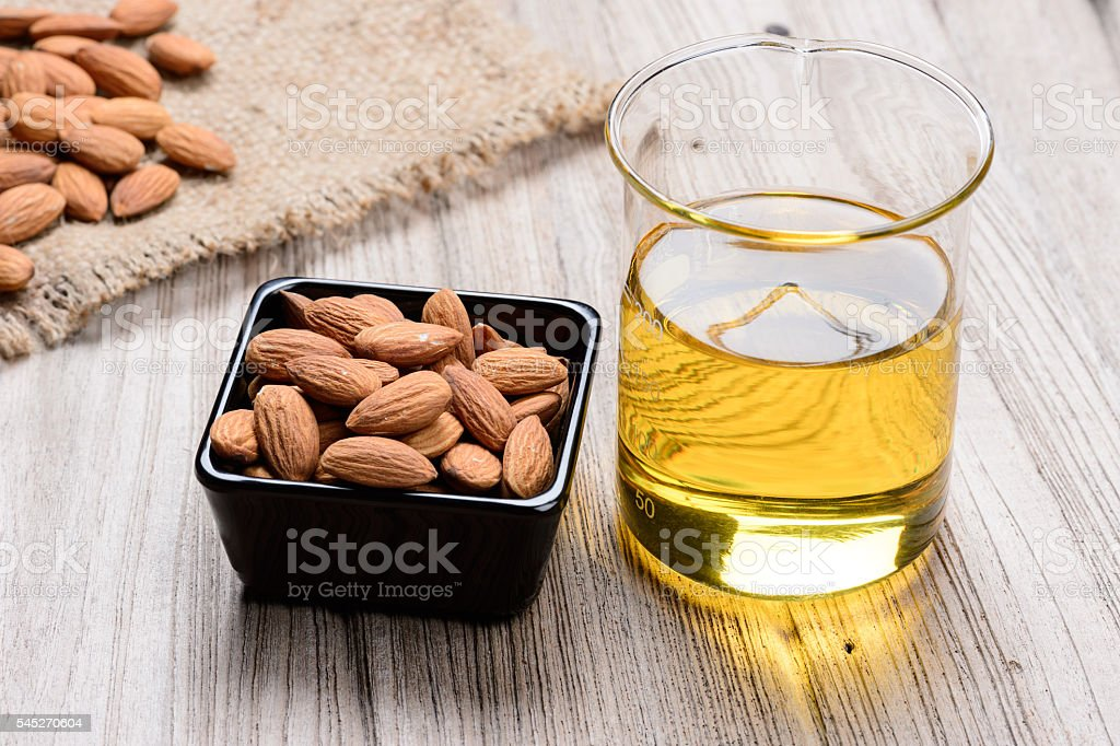almond oil in a glass bottle stock photo