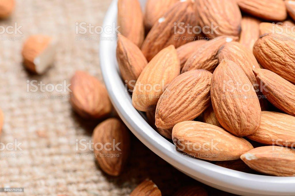 almonds - a ceramic bowl stock photo