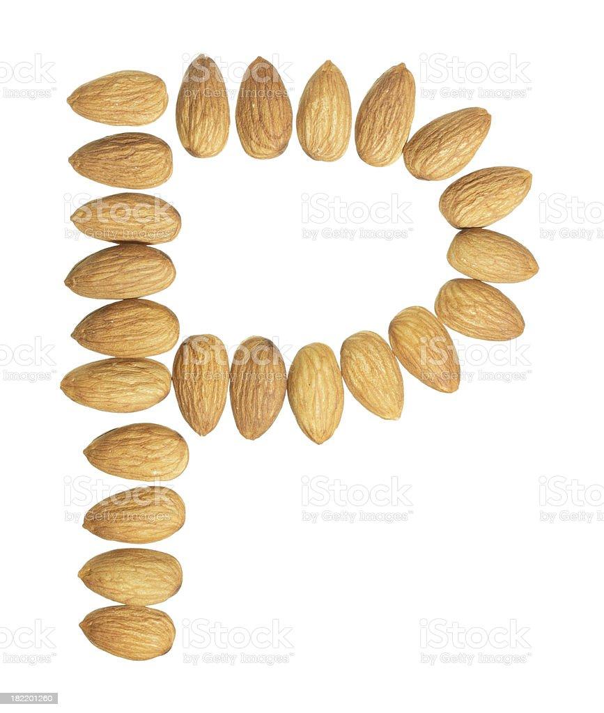 Almonds alphabet uppercase letter P royalty-free stock photo